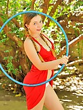 Aurielee hulahooping in the nude